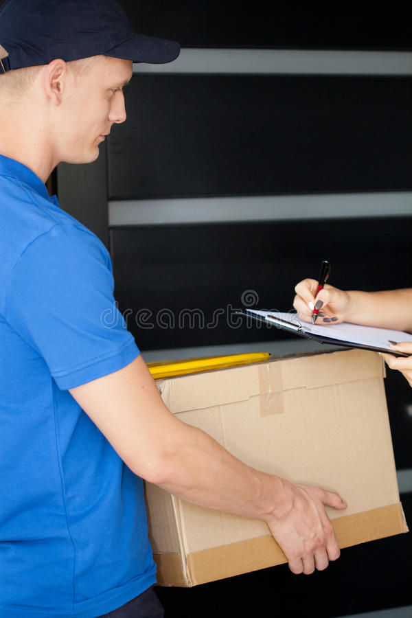 Courier delivering a parcel stock photos