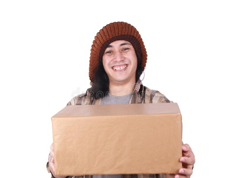 Courier Delivery Man Giving Box. Portrait of young good looking Asian courier delivery man giving box of parcel package, looking at camera amd smiling, isolated royalty free stock photography