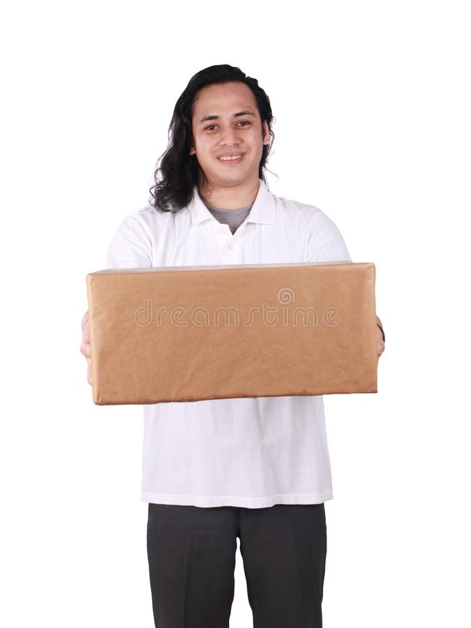 Courier Delivery Man Giving Box. Portrait of young good looking Asian courier delivery man giving box of parcel package, looking at camera amd smiling, isolated stock photos
