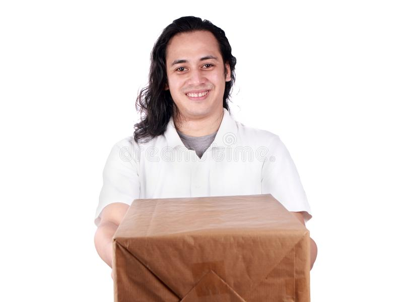 Courier Delivery Man Giving Box. Portrait of young good looking Asian courier delivery man giving box of parcel package, looking at camera amd smiling, isolated stock image