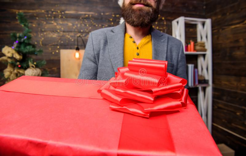 Courier giving gift. This is for you. Man santa deliver gift. Bearded guy carry present box close up. Delivery christmas royalty free stock photo