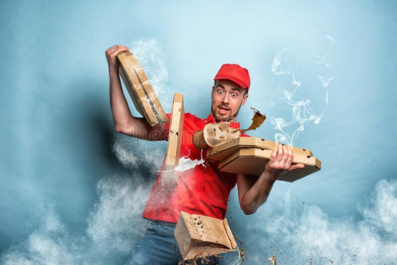 Courier has problem to delivery food because is too hot. Cyan background royalty free stock image