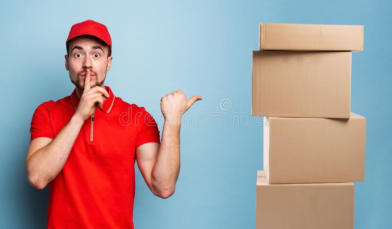 Courier has a top secret information to reveal. Emotional expression. Cyan background stock photos