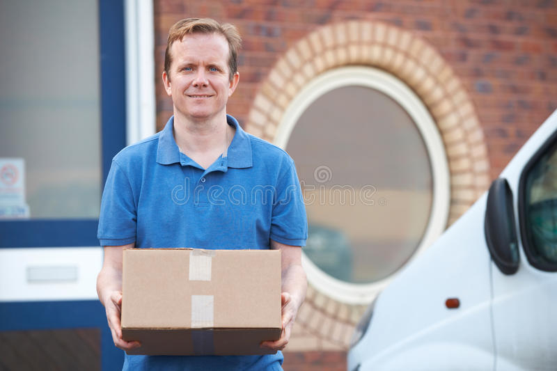 Courier Making Delivery To Office. Courier Delivers Package To Office royalty free stock photos