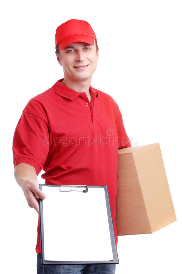 Courier in red uniform. Young man courier in red holding a box isolated on white royalty free stock image