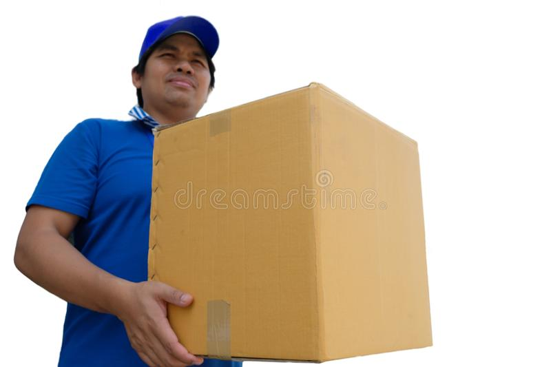 Delivery man in blue uniform handing parcel box to recipient stock photography