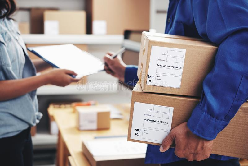 Courier signing document royalty free stock photo