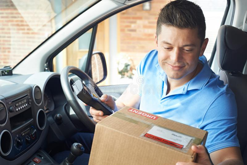 Courier In Van Delivering Package To Domestic House royalty free stock photography