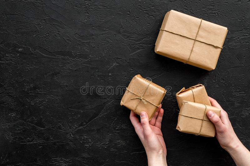 Courier workplace with cardboard box for delivery on black background top view mockup stock images