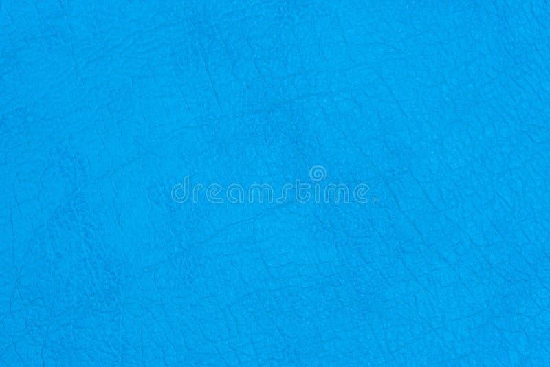 Couro de superf?cie do falso com vincos na cor azul como o fundo ou a textura foto de stock royalty free