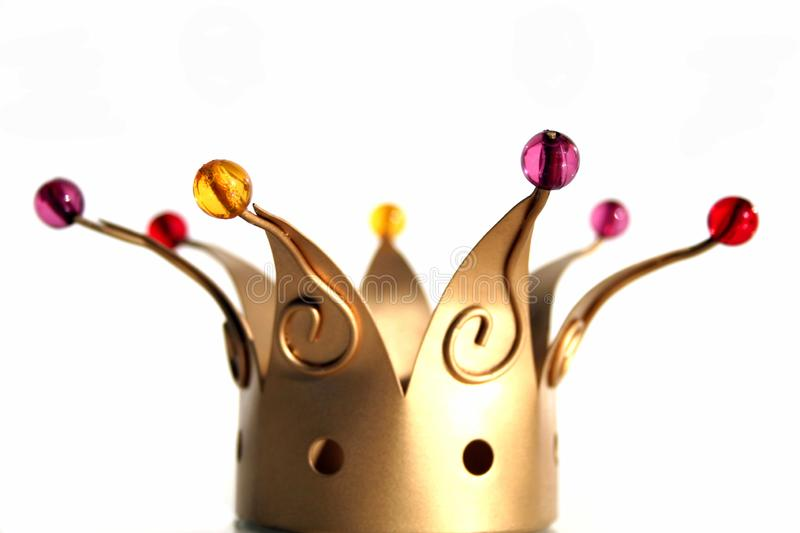 Crown Of Kings on white background. Decorative object in the shape of a golden crown of kings with pearls isolated on white background royalty free stock image
