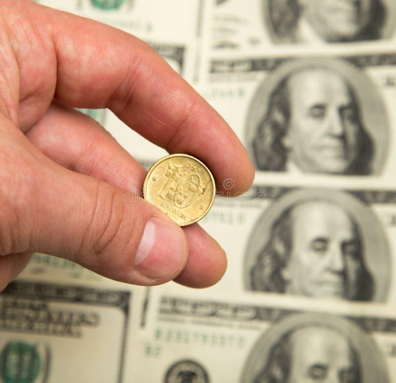 Couronne suédoise et U S Dollar photographie stock libre de droits
