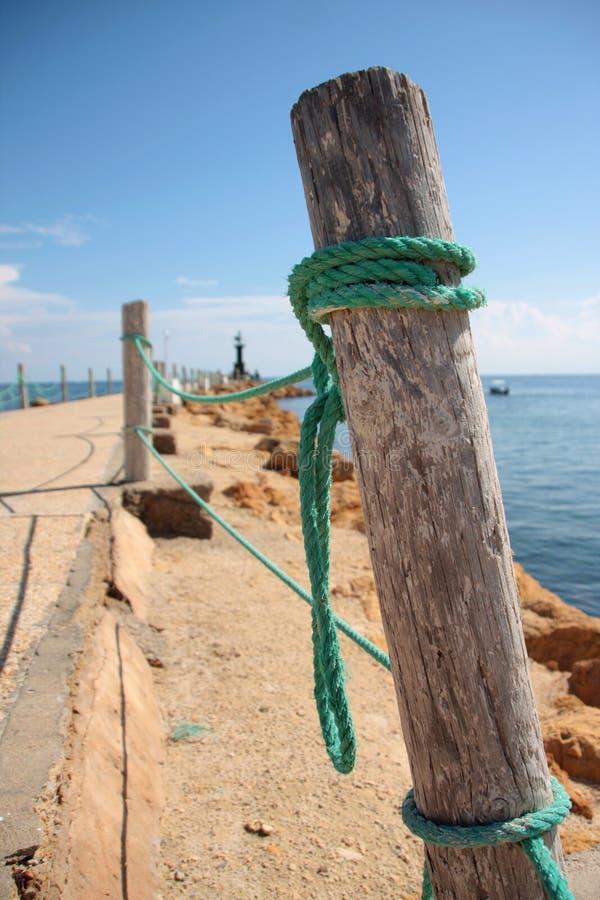 Courrier avec une corde et un Pierce photo stock