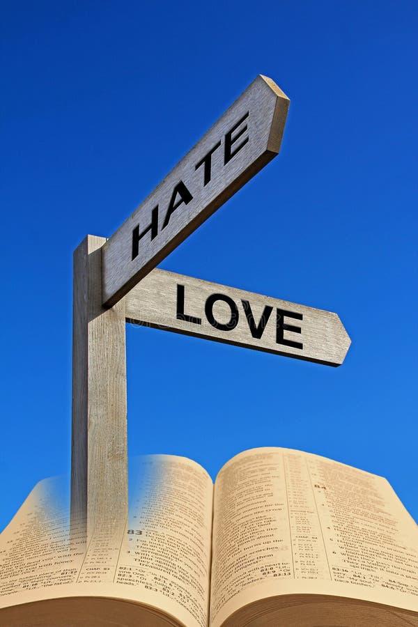 Courrier ouvert de signal de direction de flèches de haine d'amour de Sainte Bible images stock