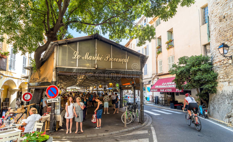 Cours Massena provencal market in the old town, Antibes. Antibes, France - June 29, 2016: day view of roofed market hall with unidentified tourists in Antibes royalty free stock photos