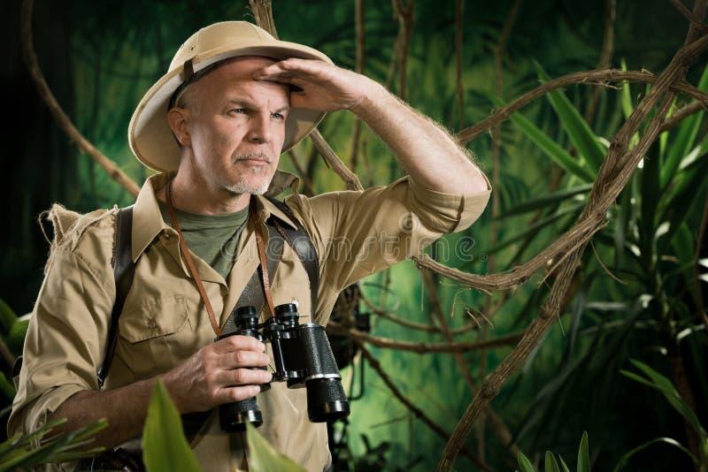 Course d'orientation dans la jungle photo libre de droits