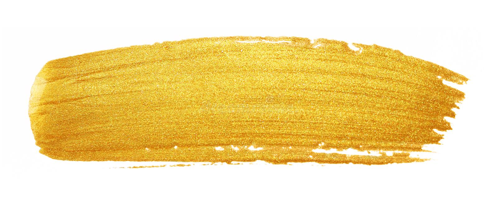 Course de pinceau de Golded Tache de calomnie de couleur d'or de scintillement sur le whi photo libre de droits