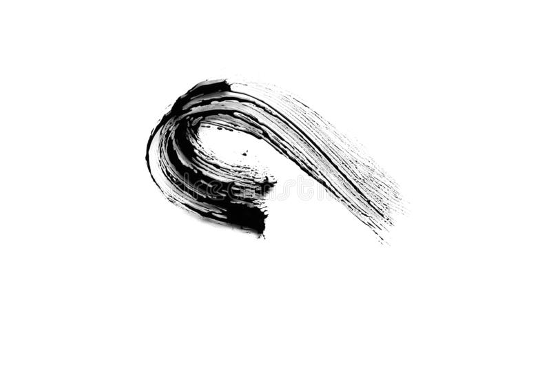Course noire de brosse de mascara sur le fond blanc photo stock