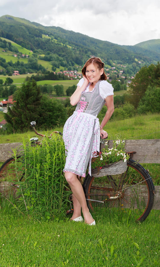 Of course, Shy and Beautifully. Portrait of a young Bavarian woman in dirndl royalty free stock image