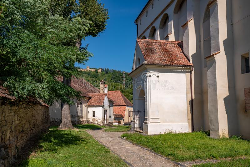 The court of fortified church in Saschiz, Transylvania, Romania. UNESCO World Heritage Site royalty free stock photography