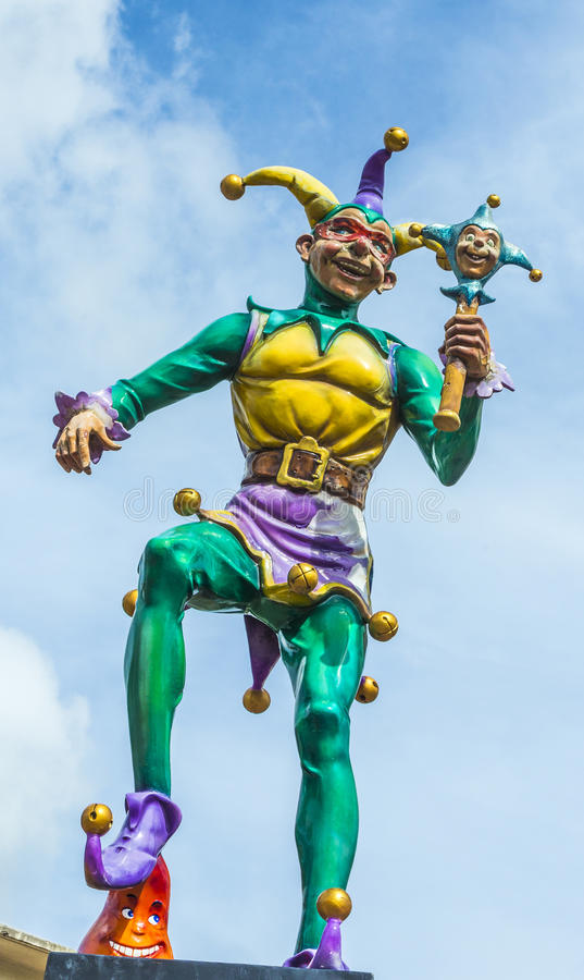 Court jester in New Orleans. At the river walk area under blue sky stock photo