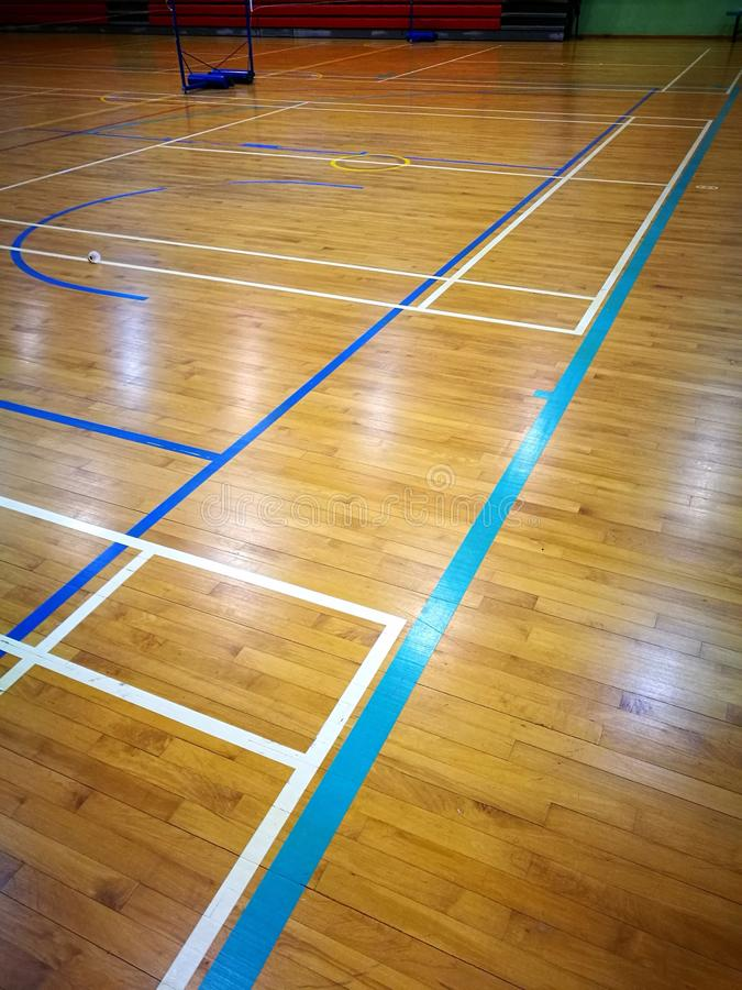 Court line markings on multi function sports hall floor stock images