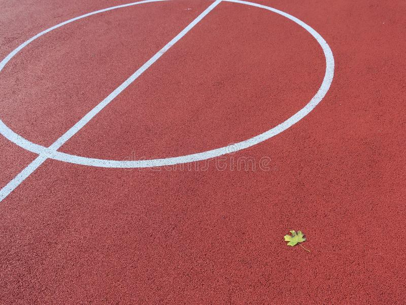 Tennis court yard with leaf stock photography