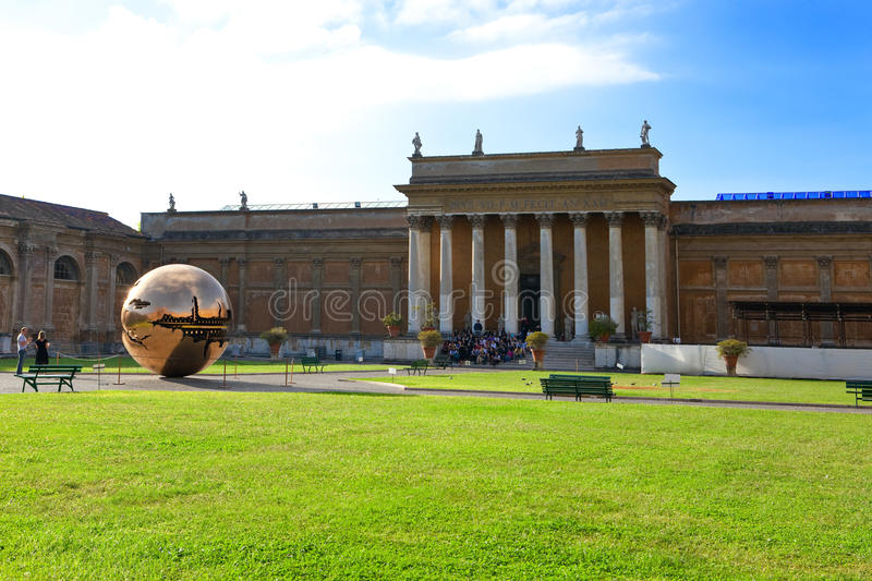 Court yard in Vatican. Sculpture the globe in cour royalty free stock photo