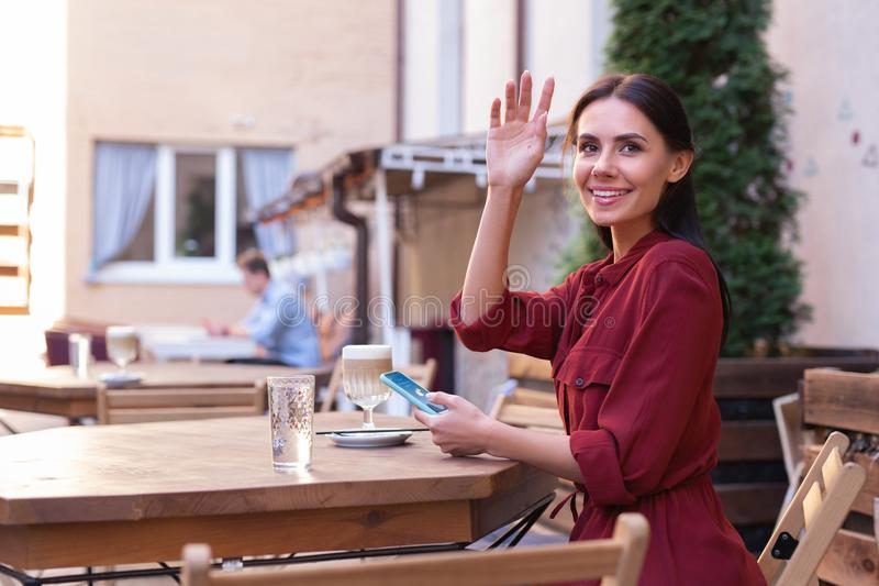 Busy courteous businesswoman calling waiter. Courteous woman. Busy courteous businesswoman calling waiter while running late for important business meeting royalty free stock images