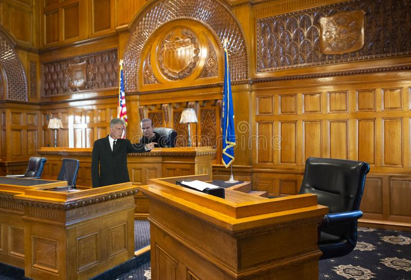 Courtroom Template, Witness Stand, Law, Lawyer, Judge. Courtroom template scene. The witness stand is empty allowing a graphic designer to insert a defendant who royalty free stock photo