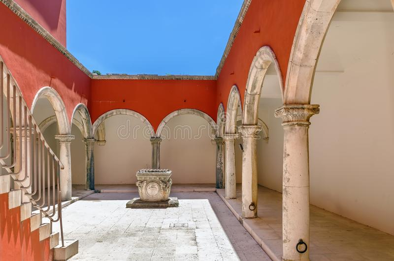 Courtyard with arcade in Zadar, Croatia. Courtyard with arcade in Renaissance Venetian Gothic style in Zadar, Croatia stock photo