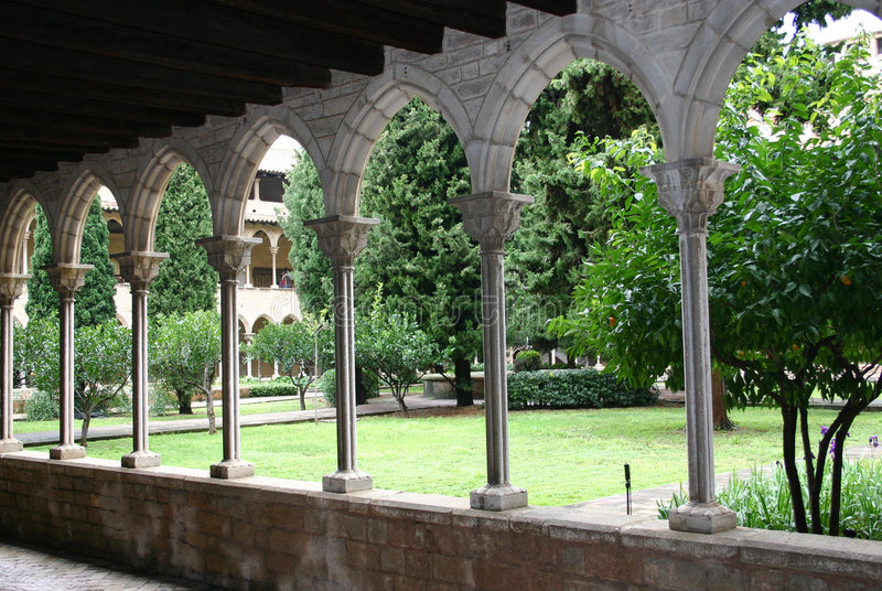Courtyard through arches stock images