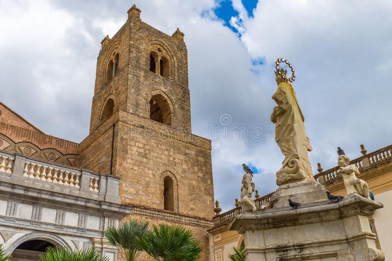 The courtyard and bell tower of Monreale cathedral of Assumption of the Virgin Mary, Sicily. Italy royalty free stock image