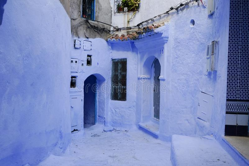 Courtyard of blue houses stock photography