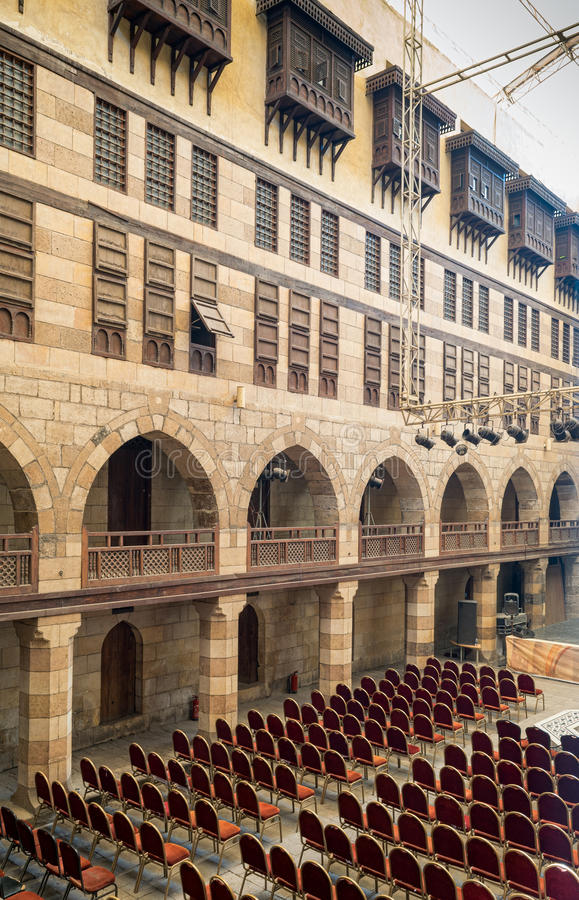 Courtyard of caravanserai Wikala of al-Ghuri, Medieval Cairo, Egypt. Courtyard of caravansary Wikala of al-Ghuri, with five floors of vaulted arcades leading to royalty free stock image