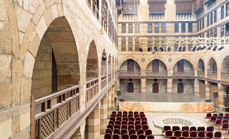 Courtyard of caravanserai Wikala of al-Ghuri, Medieval Cairo,. Courtyard of caravanserai Wikala of al-Ghuri, surrounded by two floors of vaulted arcades leading stock photos