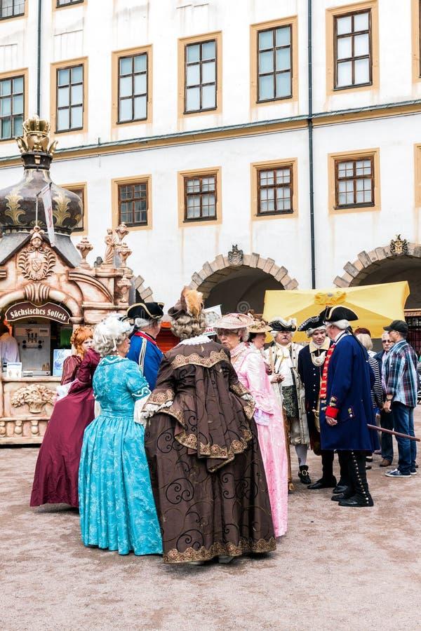 Courtyard of the castle, ladies and gentlemen in the costumes of. Ladies, gentlemen of the 18th century. Baroque Festival, Schloss Friedenstein, Gotha, Germany stock photography