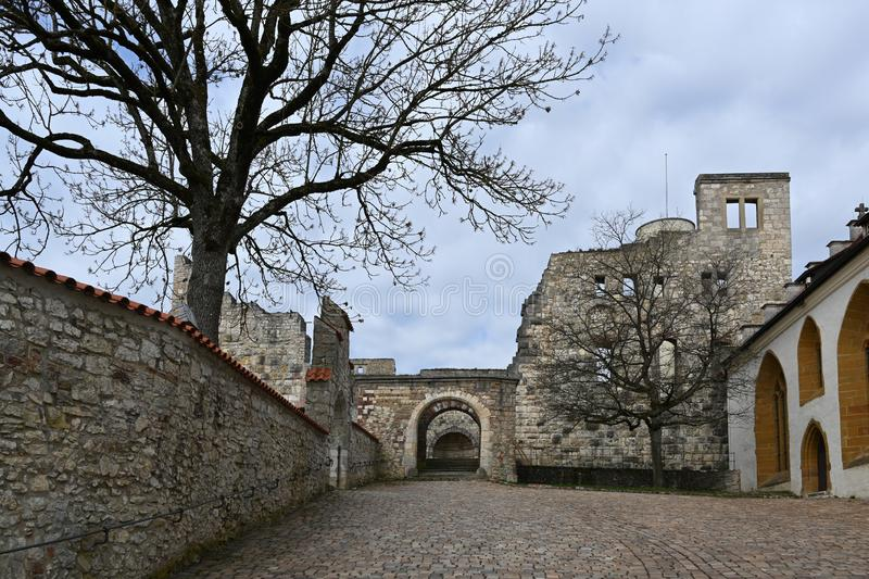 Courtyard in the castle ruin Hellenstein on the hill of Heidenheim an der Brenz in southern Germany against a blue sky with clouds. Copy space stock photos