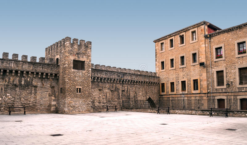 Courtyard with a castle wall royalty free stock photos