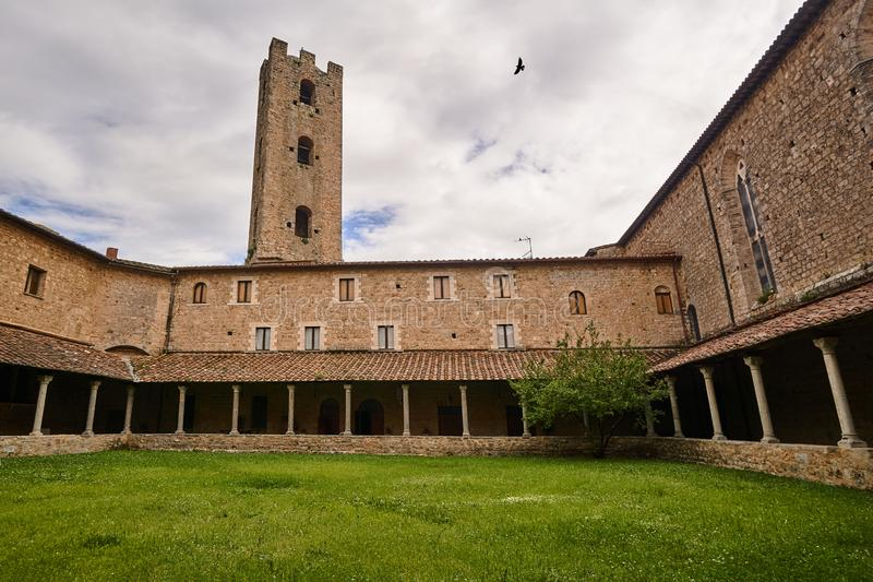 Courtyard with cloisters of a historic monastery. In the city of Massa Maritima in Tuscany royalty free stock photography