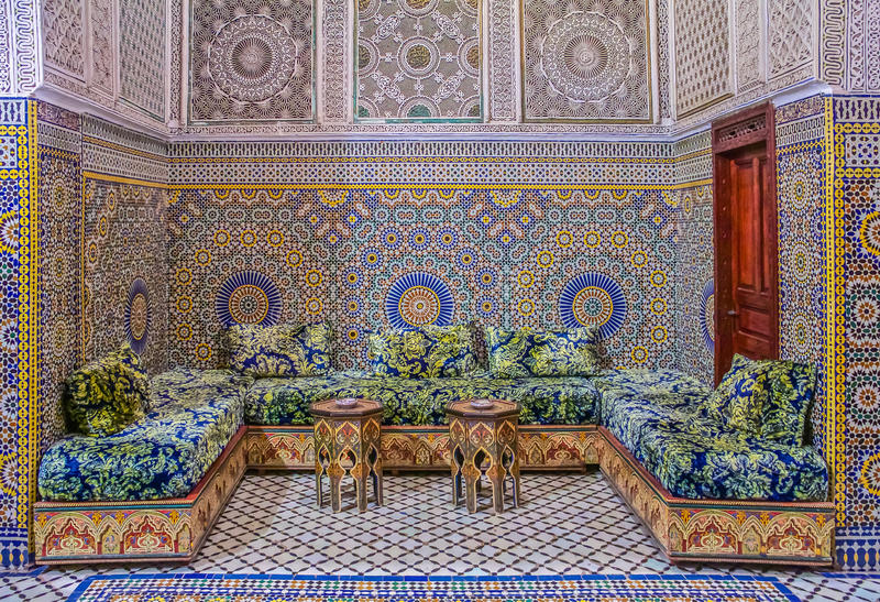 Courtyard decorated with mosaic and carvings in a Moroccan riad stock photography