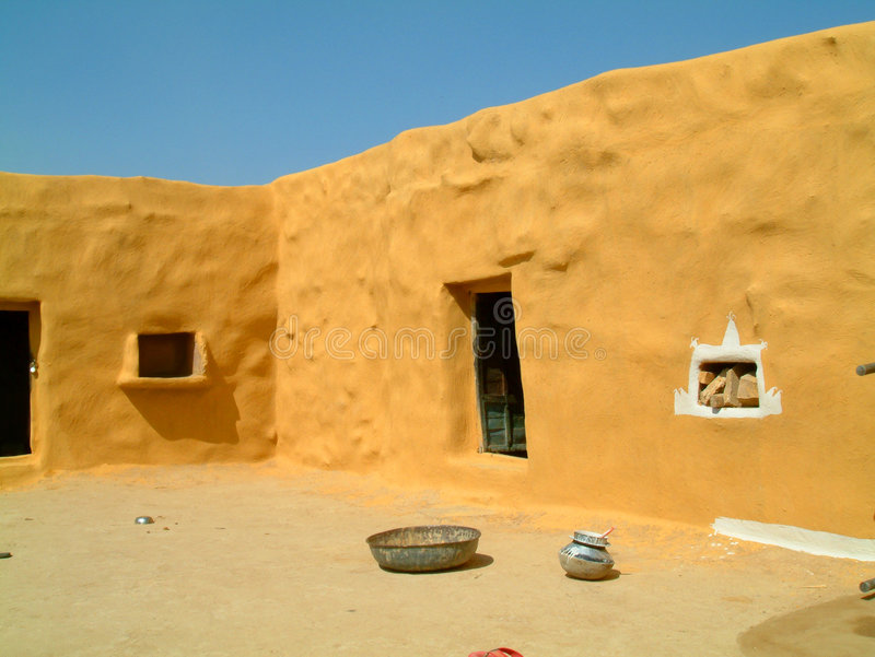 Courtyard in desert village stock photography