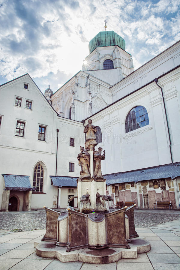 Courtyard of famous Saint Stephen's cathedral in Passau, Germany. Sunrays and religious architecture royalty free stock photos