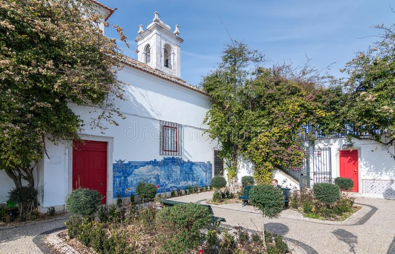 LISBOA, PORTUGAL. Courtyard with flowers of the Church of the order of Malta in Sunny weather royalty free stock image