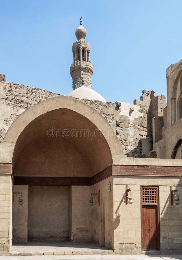 Courtyard of historic mosque of Sultan Al Nassir Qalawun with minaret in the far end, Cairo, Egypt. Main courtyard of public historic mosque of Sultan Al Nassir royalty free stock photography