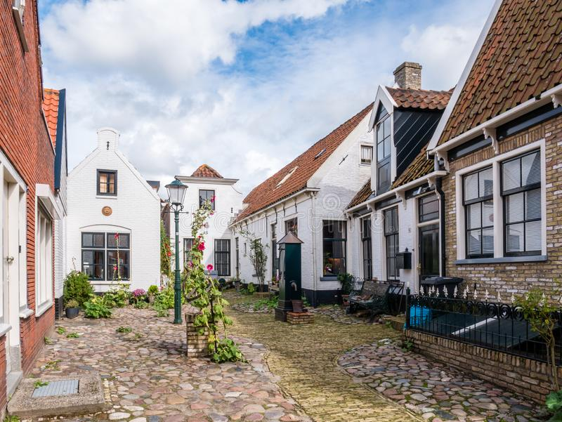 Courtyard Hofje with houses in old town of Den Burg on island Texel, Netherlands stock images