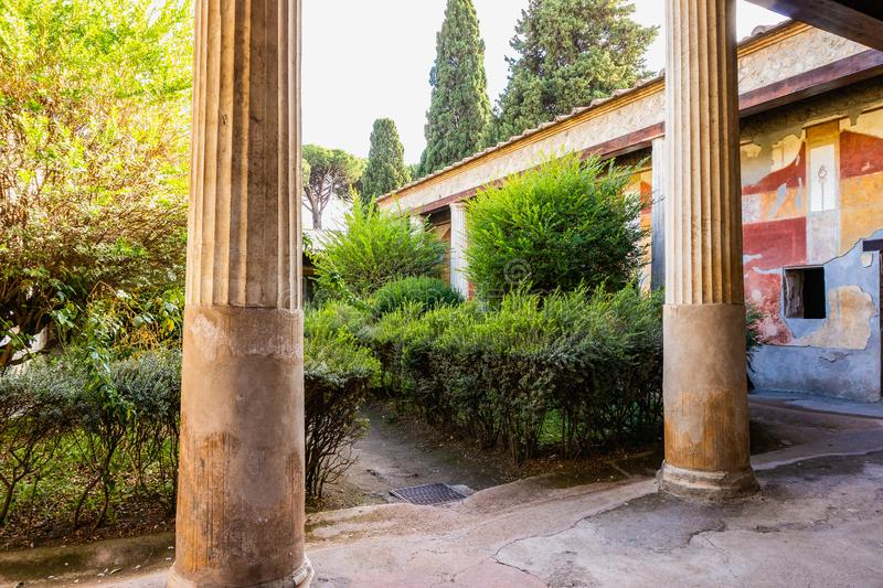 Courtyard of the house or villa in Pompeii. The ancient Roman city destroyed eruption of the volcano Mount Vesuvius, garden, antique, architecture, building stock photo