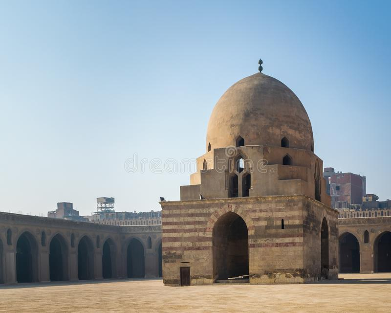 Courtyard of Ibn Tulun public historical mosque with ablution fountain and arched passages, Medieval Cairo, Egypt. Courtyard of Ibn Tulun public historical stock image