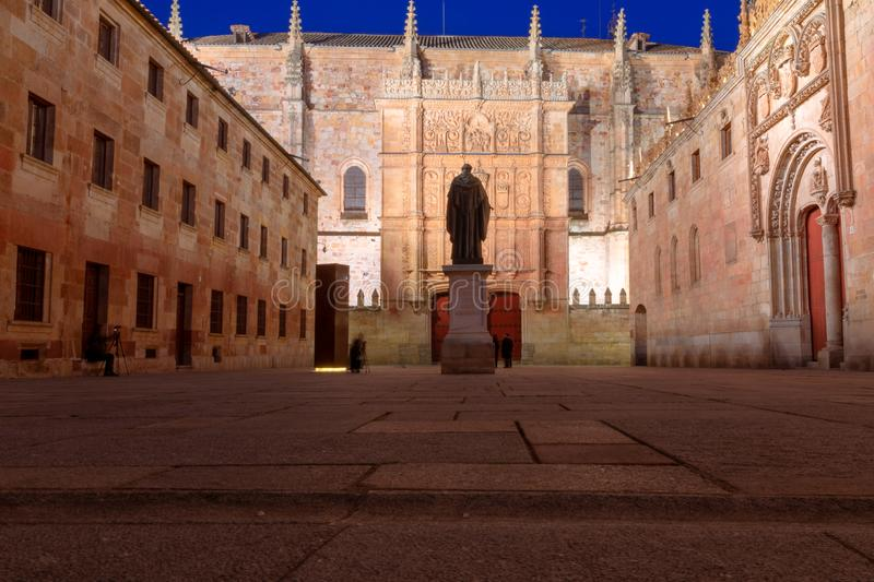 Courtyard of major schools, with the statue of Fray Luis de Leon and the façade of the old University of Salamanca. At night stock image