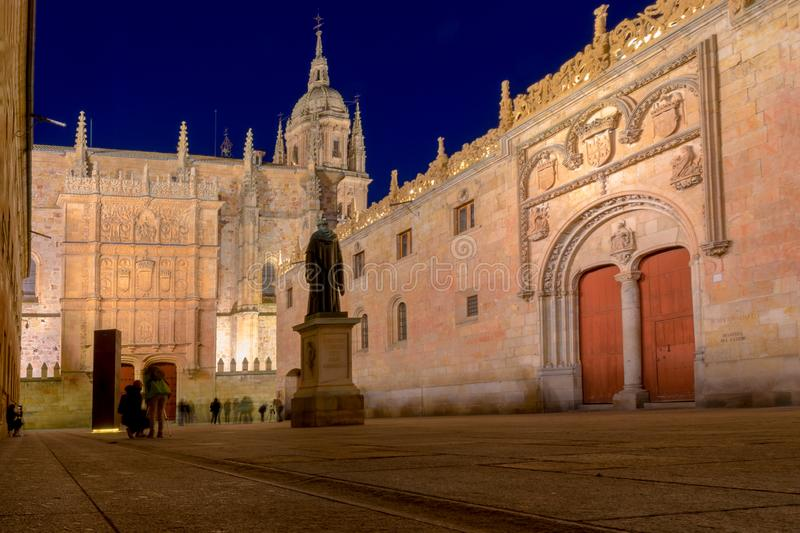 Courtyard of major schools, with the statue of Fray Luis de Leon and the façade of the old University of Salamanca. At night royalty free stock photo